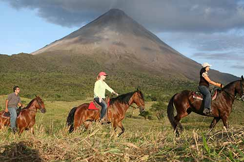 Darley riding horses at Arenal Volcano in Costa Rica
