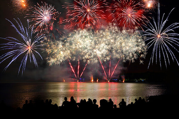 beautiful-large-colorful-fireworks-display-with-unrecognizable-crowd-people-watching