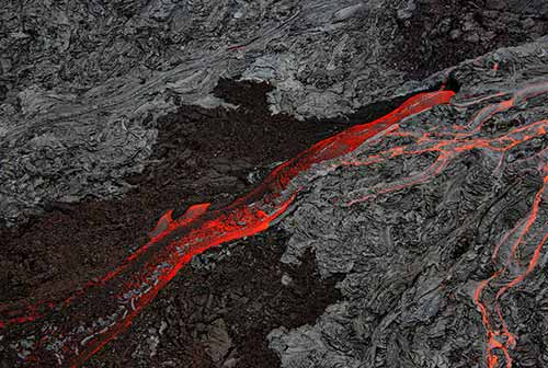 Pāhoehoe Lava and ʻAʻā flows at The Big Island of Hawaii. The picture was taken from a helicopter.