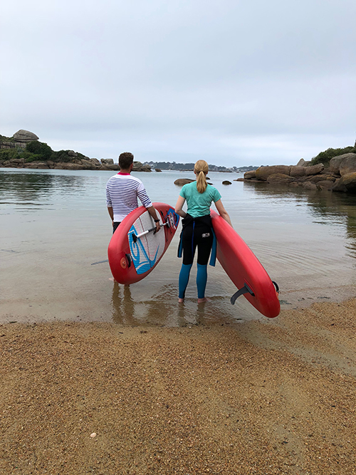 Darley Newman paddle boarding in Perros Guirec France