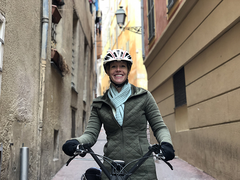 Darley biking through the streets of Nice