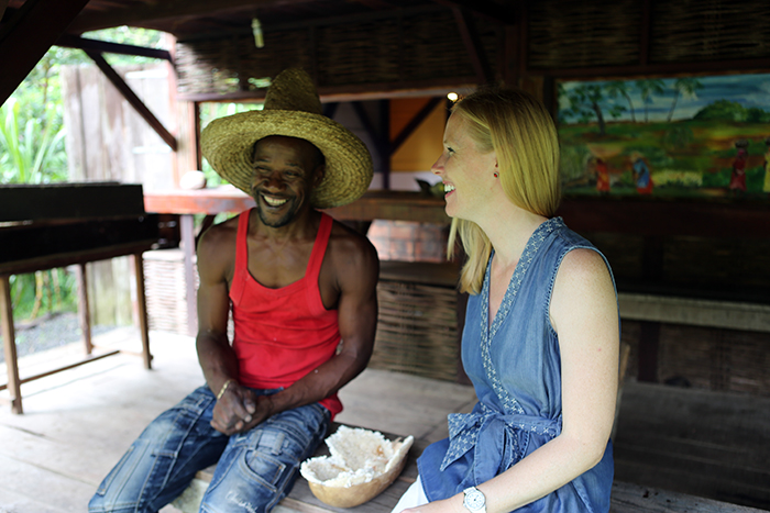 Darley trying cassava with Gilbert Larose at the Slave Savannah