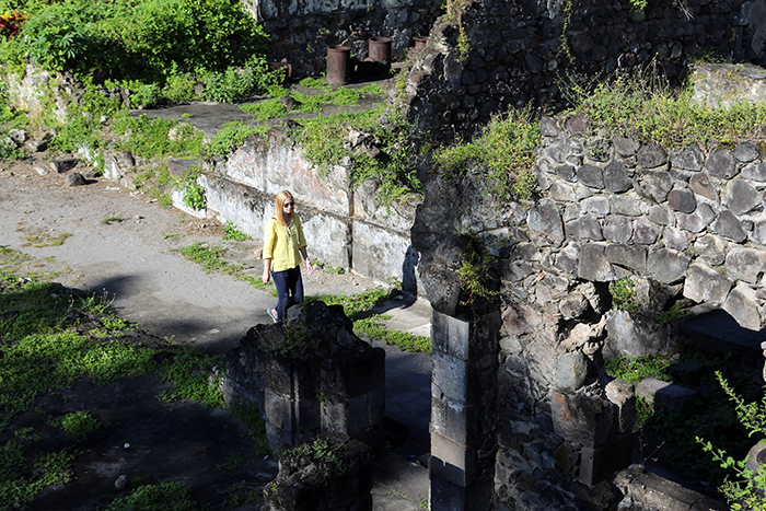 Darley explores the ruins in Saint Pierre