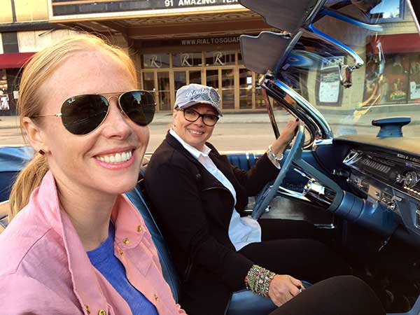 Darley Newman and DebyJo Ericksen driving by the Rialto Square Theatre in Joliet.